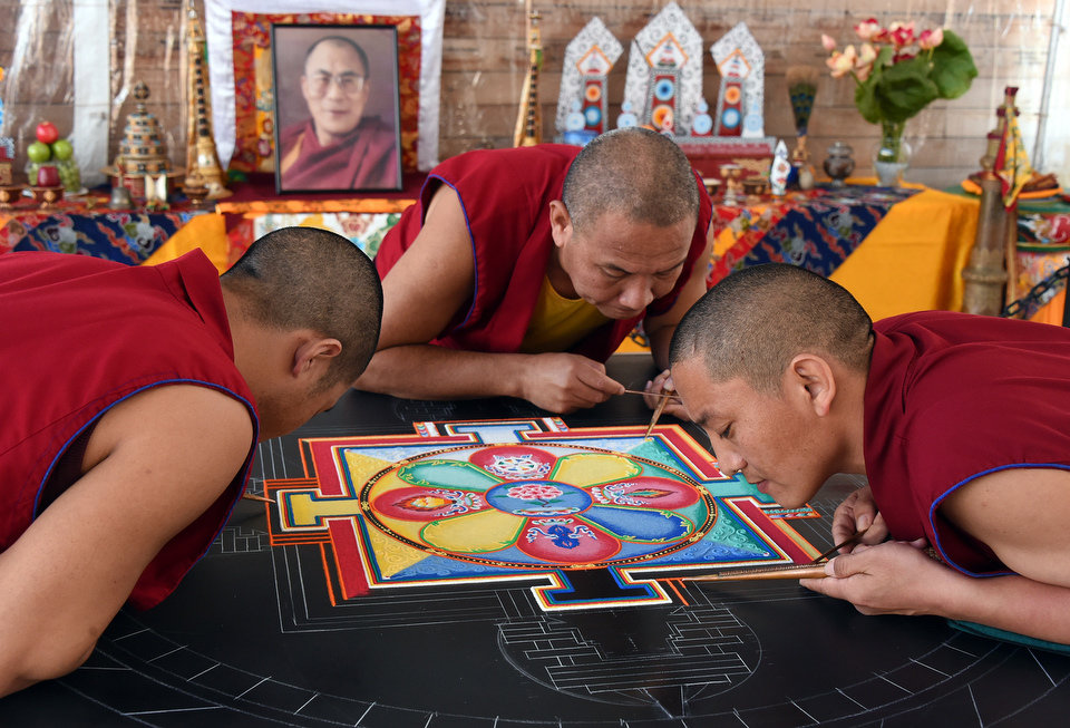 Monks Make a Mandala during a trip to Birmingham. Credit: Al.com