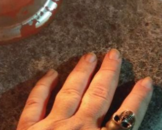 Hand with Skull Ring and Candles