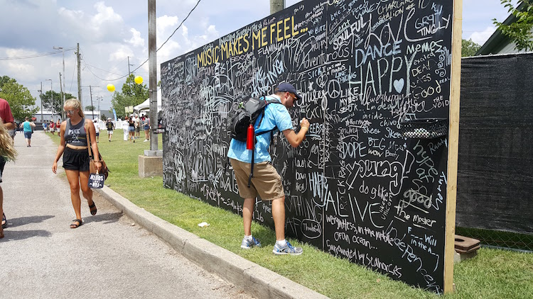 Russell Writing on the Sloss Fest Chalkboard Wall