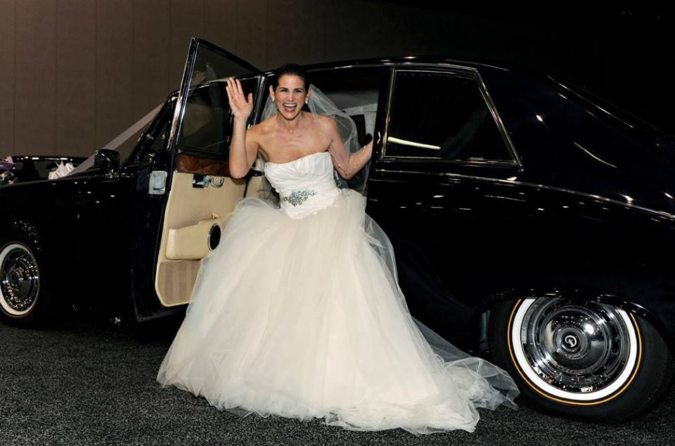 Bride getting out of a Classic Car