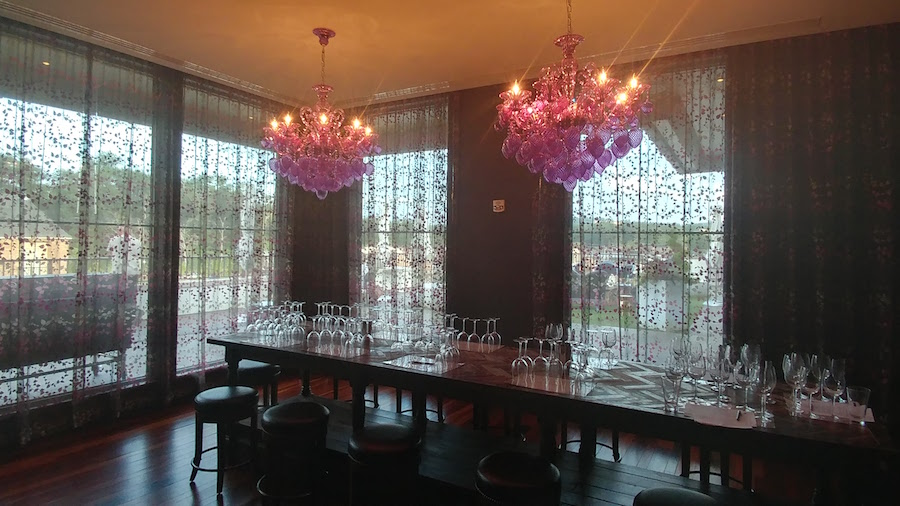 Private dining area for Wine Blending at Habitat Feed & Social with purple chandeliers
