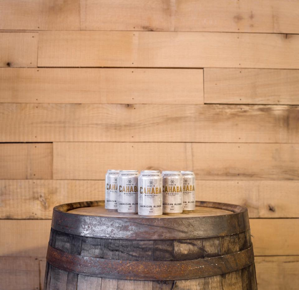 Cans on Cahaba Blonde on a Wooden Barrel