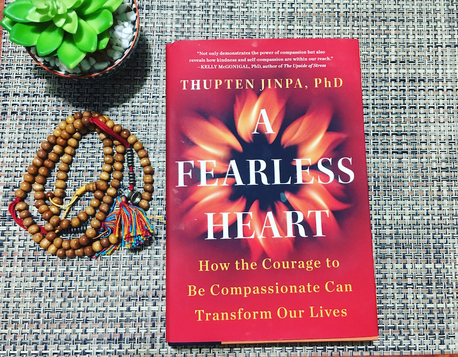 A Fearless Heart Book with prayer beads
