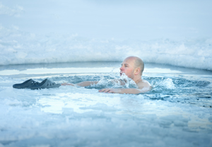 Man bathing in the ice cold water