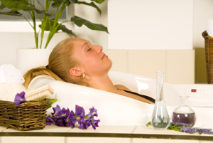 blond woman in a  essential oil bath relaxing