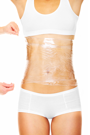 female body wrapped in plastic