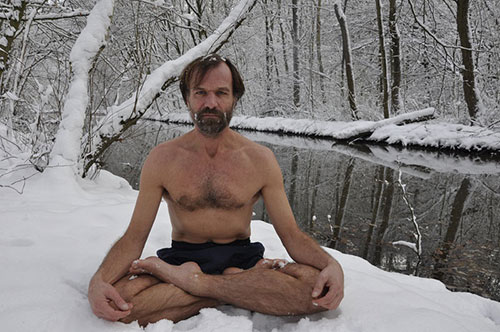 wim hof sitting in snow
