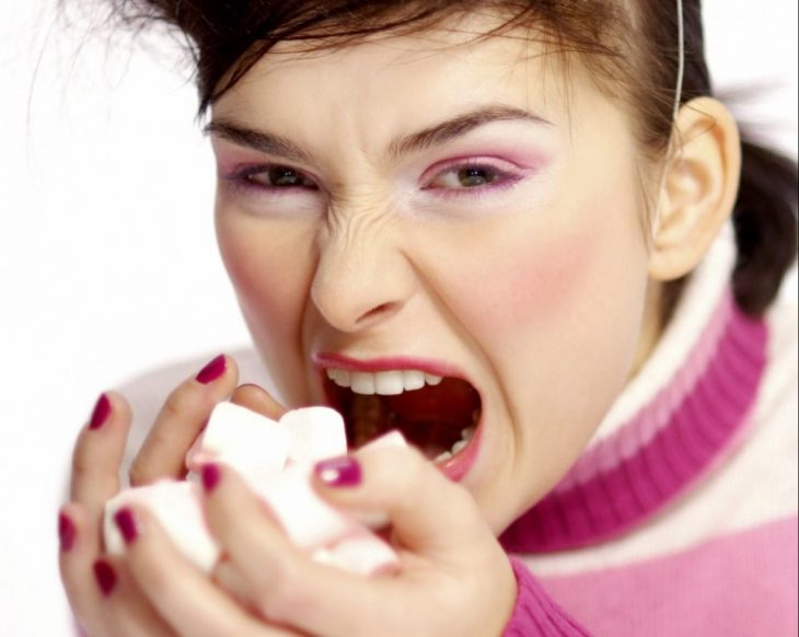 woman eating marhsmallows