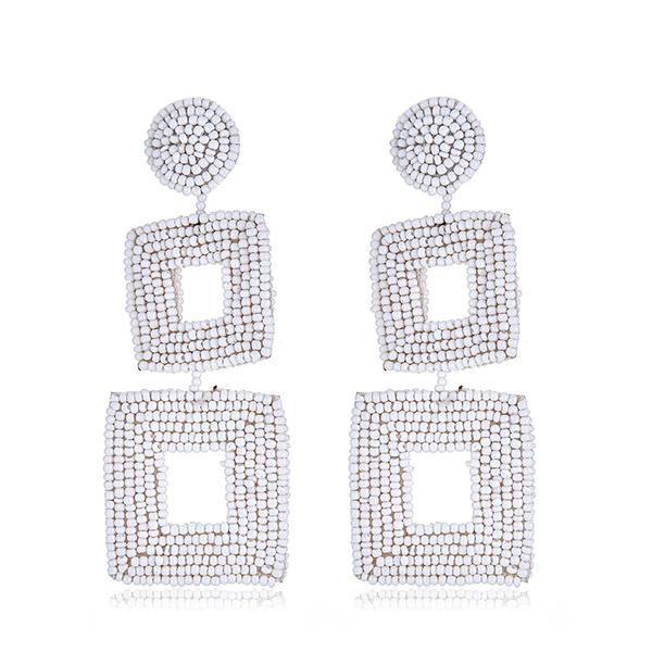 White Drop Beaded Earrings by KENNETH JAY LANE