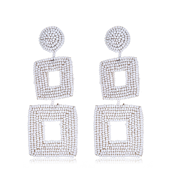 White Drop Beaded Earrings by KENNETH JAY LANE