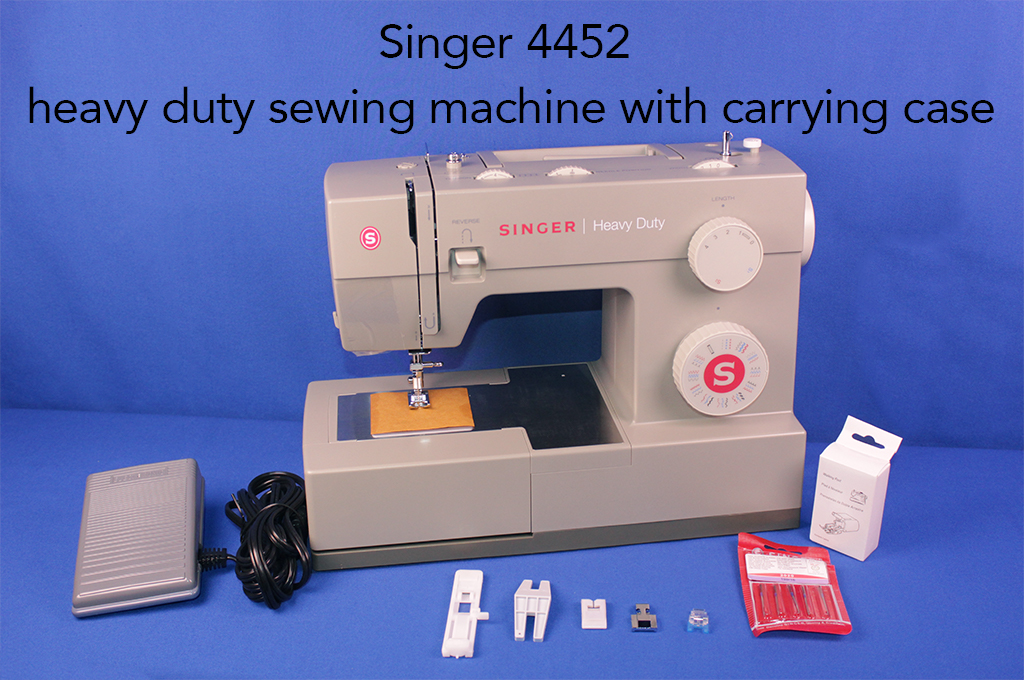 Singer 4452 heavy duty sewing machine with carrying case.