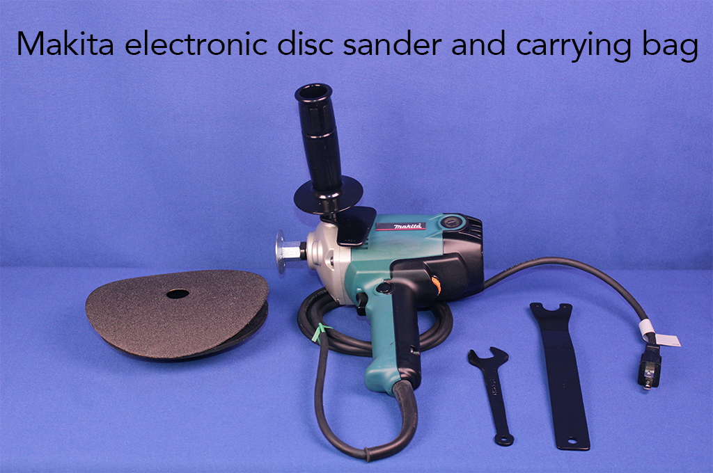 Makita electronic disc sander and carrying bag.