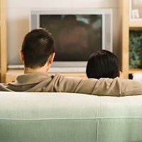 sedentary behavior, couple sitting, watching television