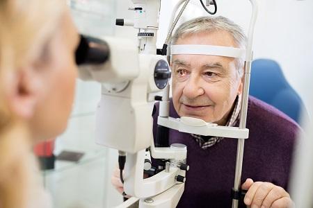Eye doctor examines patient
