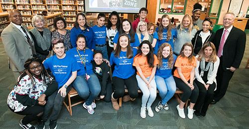 Dr. Martirano, Central Office Staff, and Board members standing with student bullying prevention group.