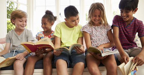 Students reading books in a group.