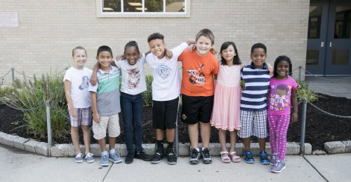 Group of students in front of Cradlerock Elementary School building.