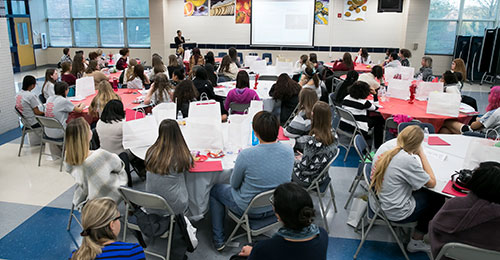 Educators rising event photo of students listening to speaker
