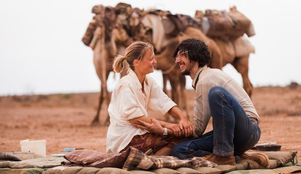 Mia Wasikowska and Adam Driver in Tracks movie film with camels, walk across Australia - HeadStuff.org