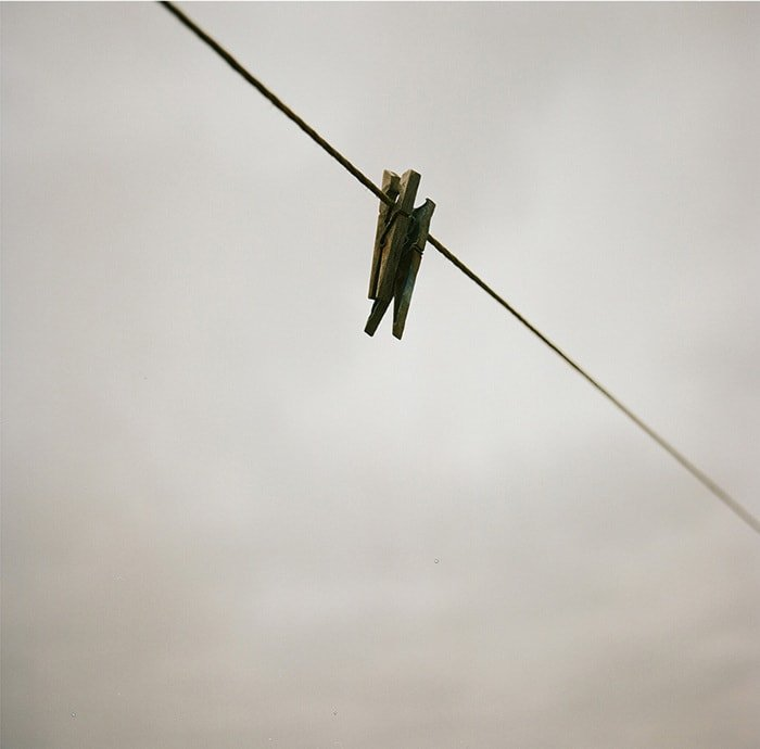 Two pegs on a washing line, sad looking pegs, couple, two against the world, two hanging on, two together, hanging on for dear life, just a couple in a vast expanse, Things Were Better Then, Ruth Connolly, Photography, photographer, artist - HeadStuff.org