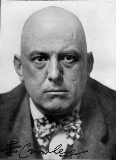 Aleister Crowley, age 37, author, hedonist, satanist, the wickedest man in the world, STDs, Golden Dawn, cults, occult, Thlemic, close-up, face - HeadStuff.org
