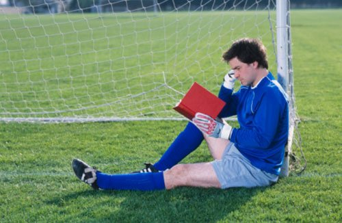 Football player reading, in marriage shock, scandal, clever player, no scandals, nice guy, likeable, satire - HeadStuff.org