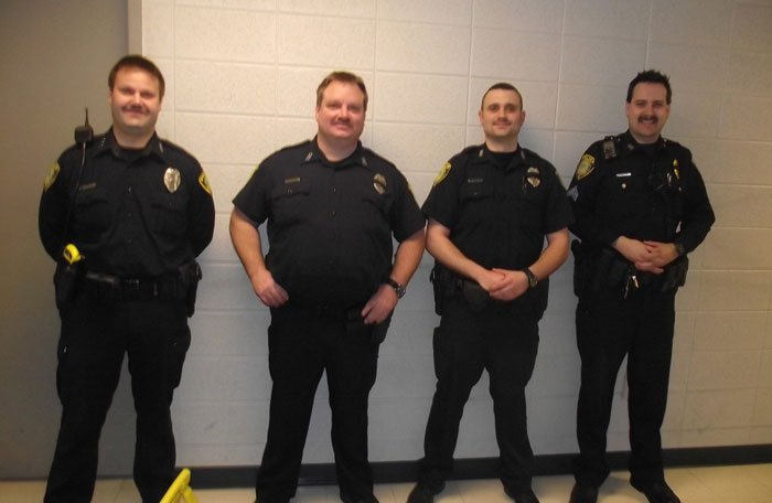 Officers of the Village of Greendale police department in Wisconsin show off their facial hair, moustache, history of cops with moustaches, movember, police tache - HeadStuff.org