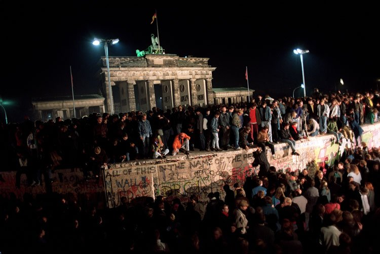 The party in Berlin on 9th of November 1989 after the unofficial fall of the berlin wall, impromptu party, east and west together again, embraced - HeadStuff.org