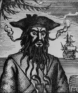 Circa 1715, Captain Edward Teach (1680 - 1718), better known as Blackbeard, a pirate who plundered the coasts of the West Indies, North Carolina and Virginia. His hair is woven with flaming fuses to increase his fearsome appearance - HeadStuff.org