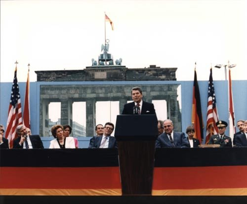 "President Reagan's visit to Berlin in 1987 for the 750th anniversary of its founding. His ""Tear down this wall!"" speech received little coverage at the time, but later became an iconic moment in the mythology of the Wall's fall - HeadStuff.org"