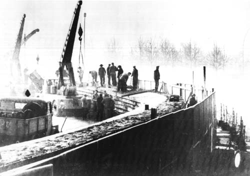 A picture of the 1975 construction of The Berlin Wall underway, the fall of the wall, 1989 - HeadStuff.org