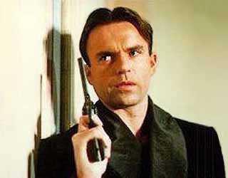 """Sam Neill in """"Reilly, Ace of Spies"""". The theme music was from Shostakovich's Gadfly suite - which had been written for a film of Voynich's novel - HeadStuff.org"""
