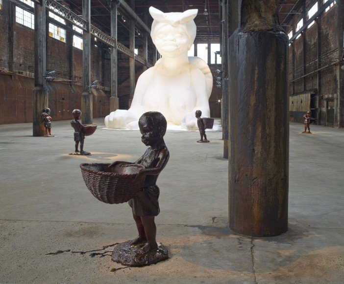 Kara Walker, A Subtlety, or the Marvelous Sugar Baby, an Homage to the unpaid and overworked Artisans who have refined our Sweet tastes from the cane fields to the Kitchens of the New World on the Occasion of the demolition of the Domino Sugar Refining Plant-Headstuff.org