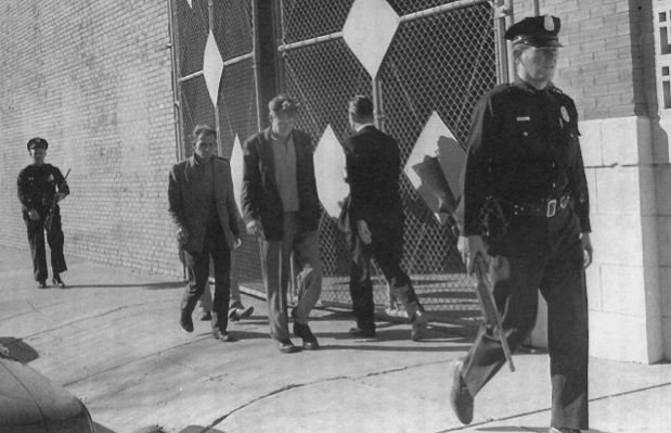 Photo of three tramps being arrested on the day of Kennedy's assassination - headstuff.org