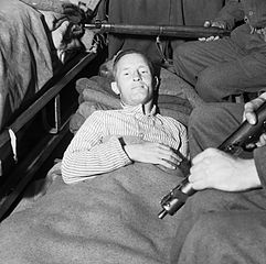 Wiliam Joyce, Nazi propagandist, in a hospital bed after his capture by the Allies - headstuff.org