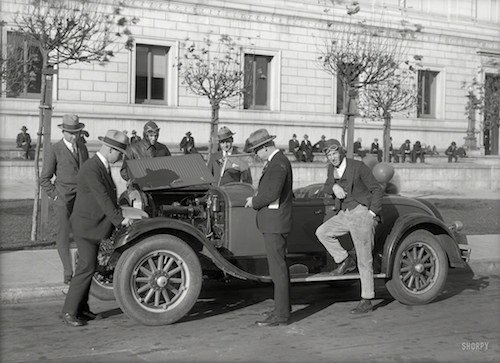 Old Timey Men Standing Around A Car - HeadStuff.org