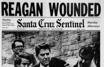 A newspaper's front page with a photo of the aftermath of the gun attack on President Reagan