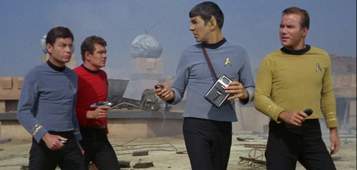 Bones, Spock and Kirk in Season 1 of Star Trek TOS. Also featuring a red shirt who probably survived and lived a long and happy life. - HeadStuff.org