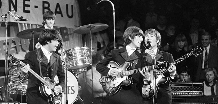 The Beatles playing live at the height of 'Beatlemania.' Source