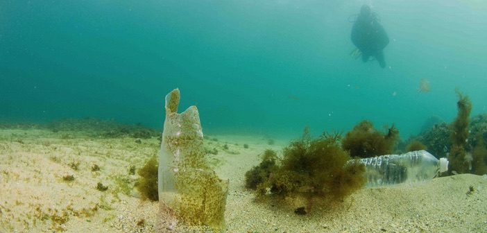 plastic bottles on ocean floor