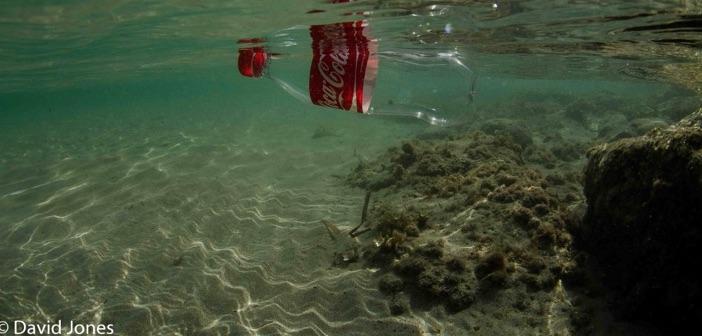 plastic coke bottle in ocean