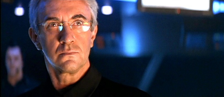Jonathan Pryce as Elliot Carver in Tomorrow Never Dies. - HeadStuff.org