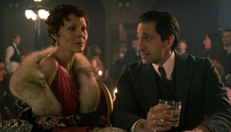 Helen McCrory as Polly Shelby and Adrien Brody as Luca Changretta in Peaky Blinders. - HeadStuff.org