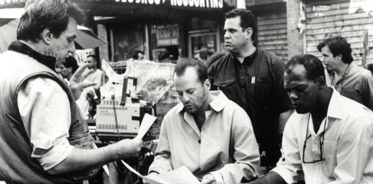McTiernan (left) with Willis and Jackson on the set of Die Hard With A Vengeance. - Headstuff.org