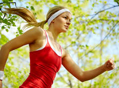Young-woman-running-exercising-outside-fit-healthy
