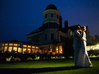 bride and groom kiss outside Newport RI hotel Castle Hill Inn