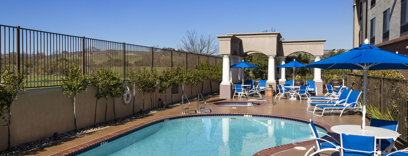 Pool Area with Chairs at Hampton Inn Paso Robles