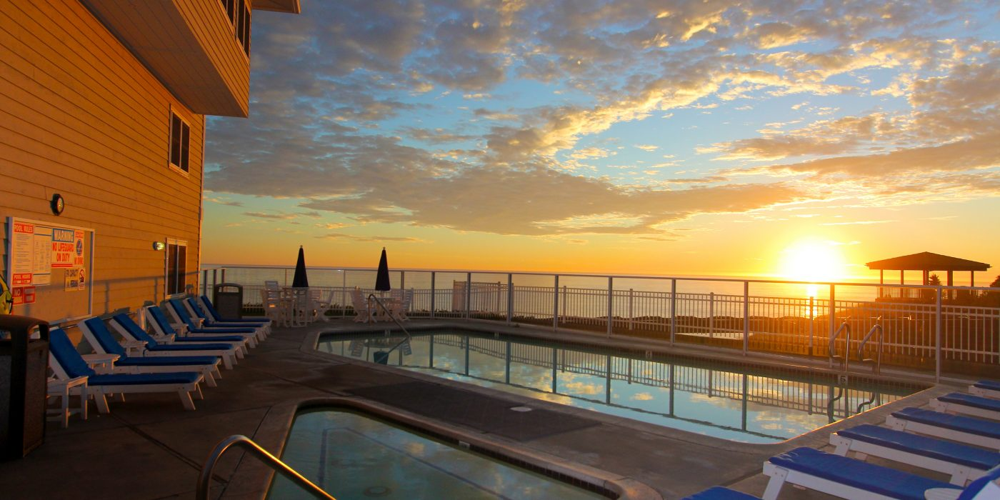 Gorgeous sunset reflecting off Pismo Lighthouse Suties pool