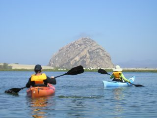 Couple kayaking on calm waters in Morro Bay