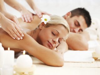 Young couple getting relaxing massage